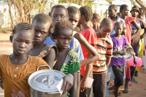 South Sudan: Orphans and refugees waiting all day for food.